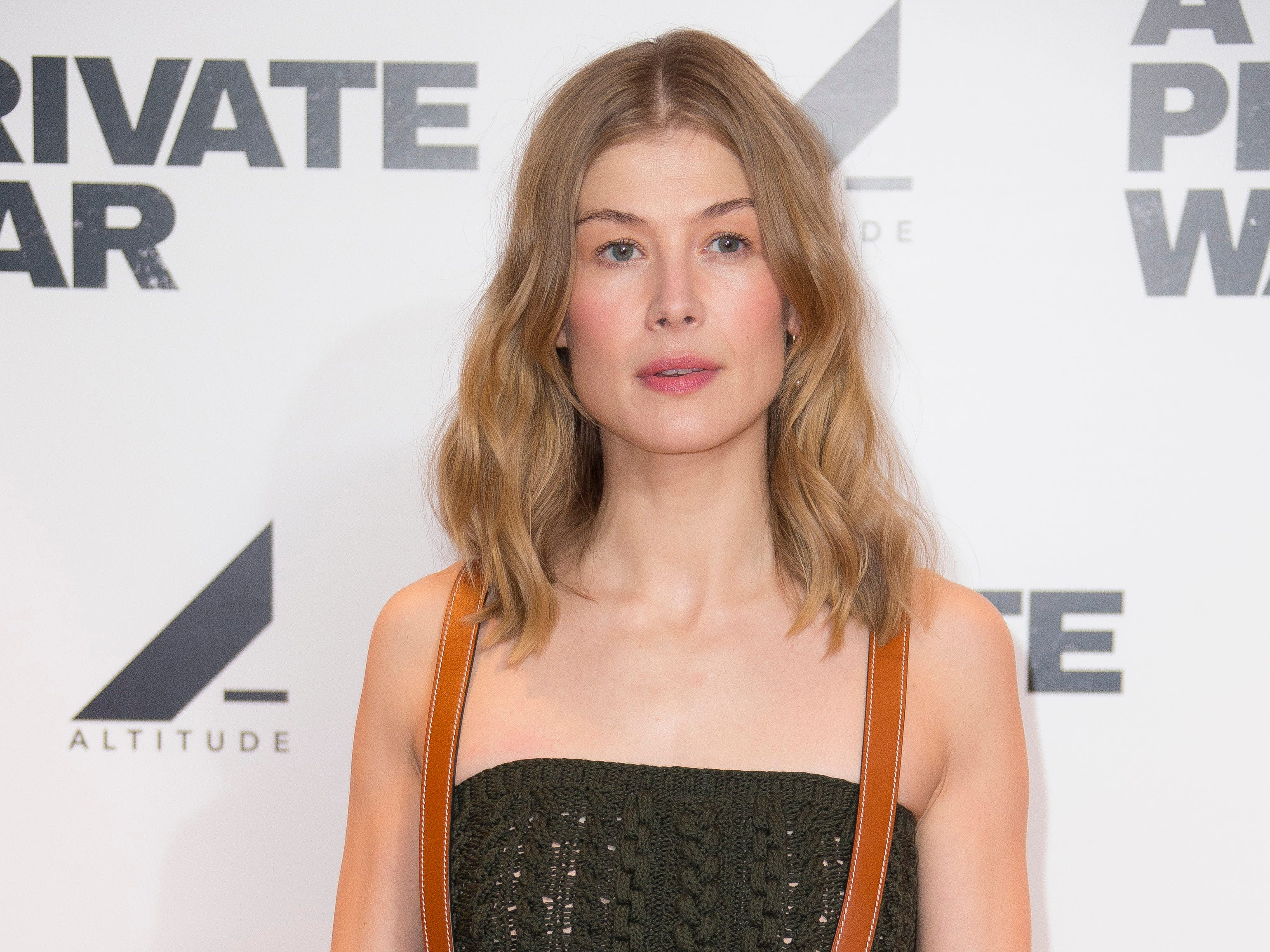 Actress Rosamund Pike poses for photographers upon arrival for a photo call for A Private War, at a central London cinema, Monday, Feb 4, 2019. (Photo by Joel C Ryan/Invision/AP) ORG XMIT: LENT106