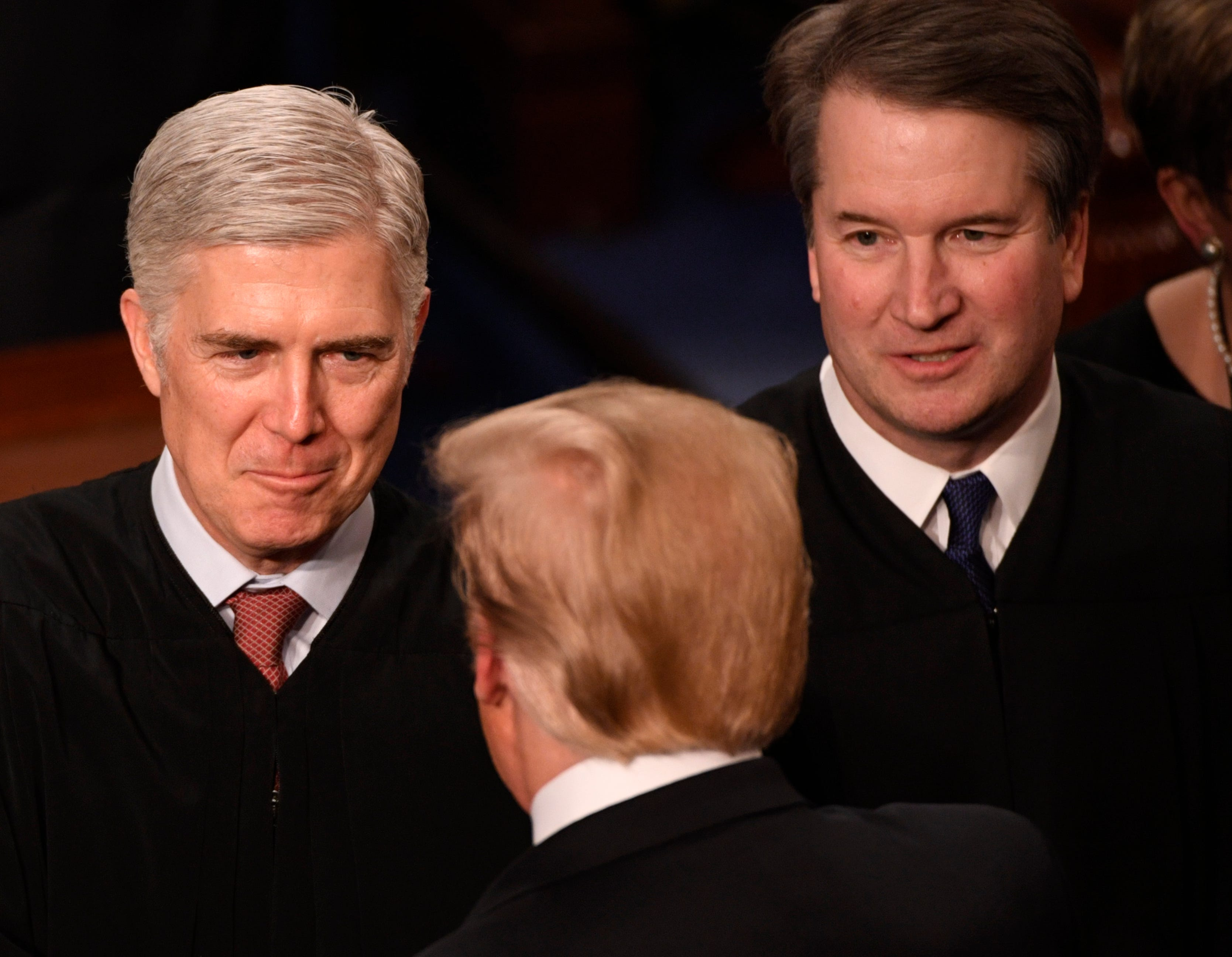 Justices Neil Gorsuch and Brett Kavanaugh greets President Donald Trump before he delivers the State of the Union address.