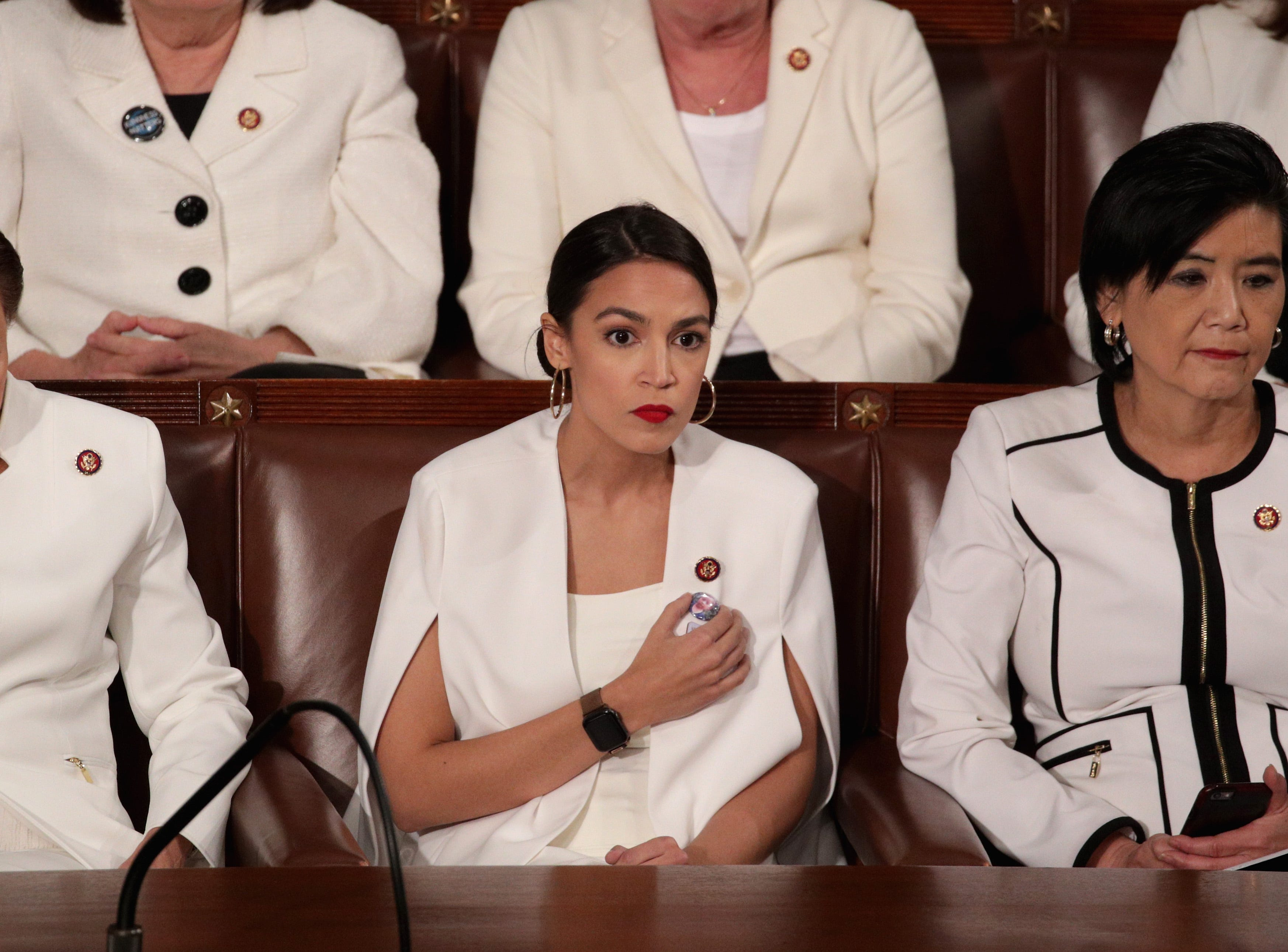 6a8a7bf0 Alexandria Ocasio-Cortez responds to tweet: Why should I be 'spirited and  warm' at State of the Union? 4 Months ago