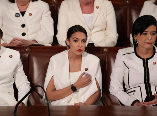 Rep. Alexandria Ocasio-Cortez (D-NY) watches President Donald Trump's State of the Union address in the chamber of the U.S. House of Representatives.
