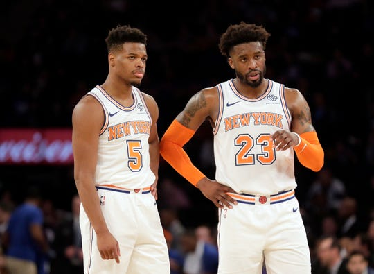 New York Knicks' Wesley Matthews, right, and Dennis Smith Jr. talk during the second half of an NBA basketball game against the Memphis Grizzlies, Sunday, Feb. 3, 2019, in New York.