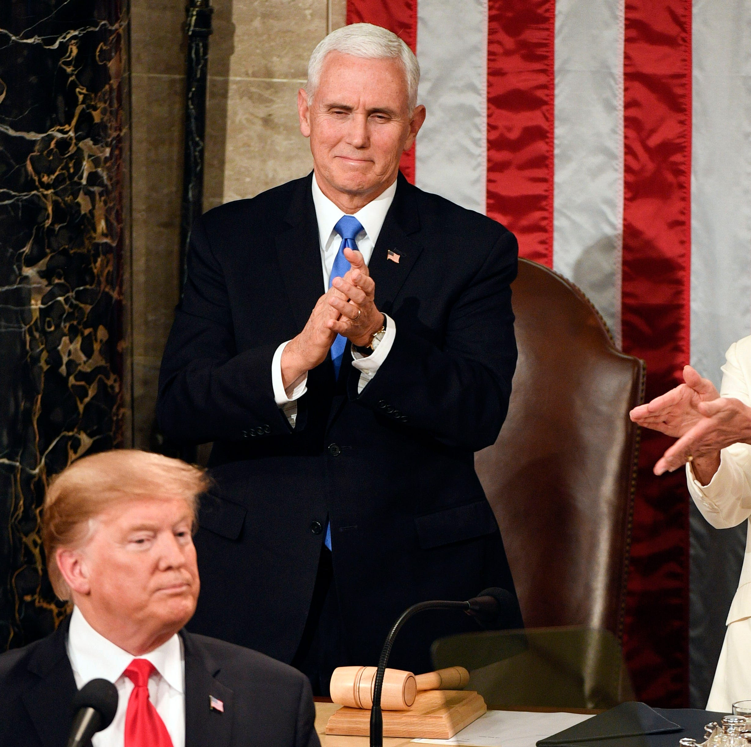 Speaker of the House Nancy Pelosi, D-Calif., claps toward President Donald Trump as he delivers the State of the Union address from the House chamber of the United States Capitol in Washington Feb. 5, 2019. Vice President Mike Pence is behind Trump.