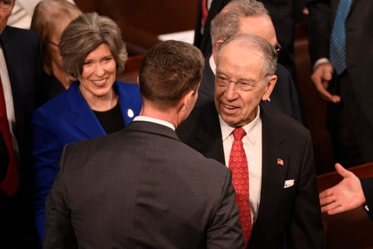 Sen. Joni Ernst (R-Iowa) and Sen. Chuck Grassley (R-Iowa), right, chat before President Donald Trump delivers the State of the Union address.