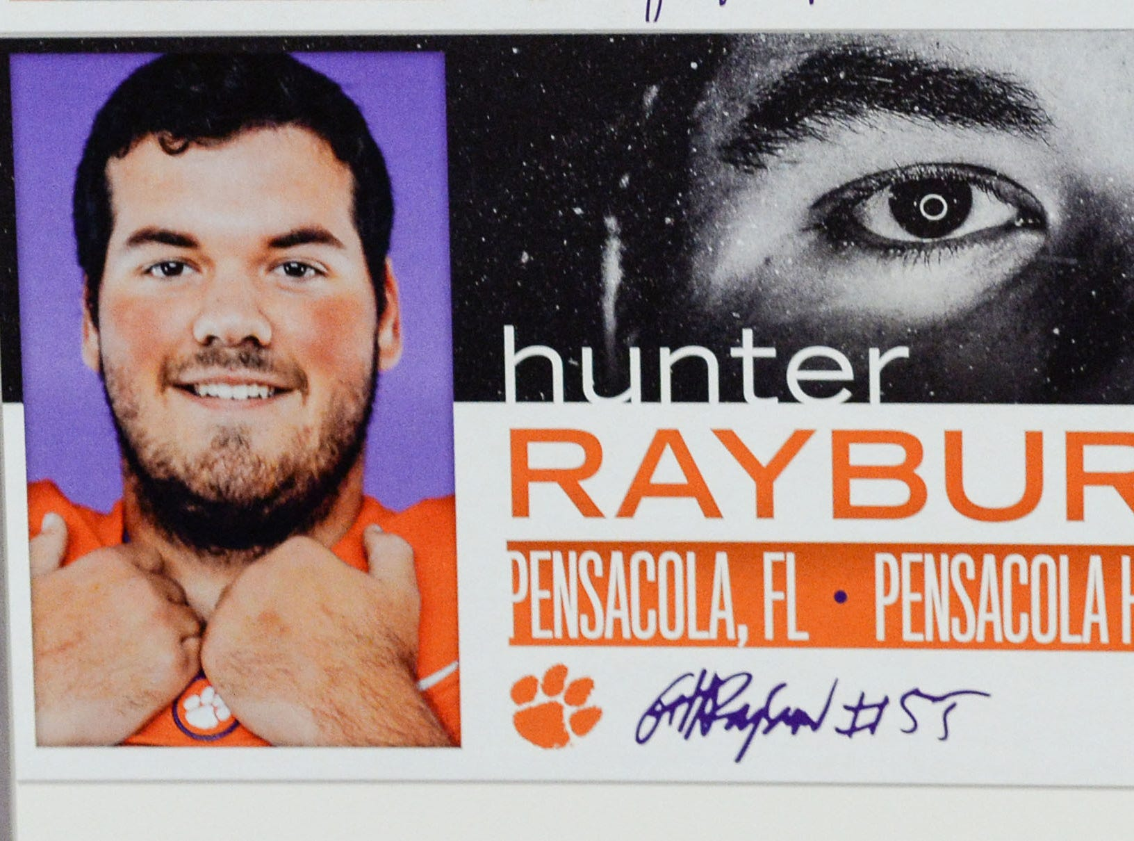 A photo of Hunter Rayburn, an offensive lineman from Pensecola, Florida, is displayed in the team meeting room for a National Letter of Intent signing day press conference in Clemson Wednesday, February 6, 2019.
