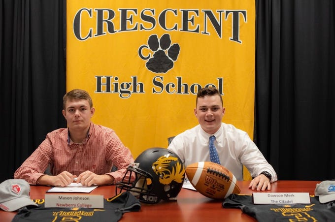 Crescent seniors Mason Johnson, left, has signed to play football at Newberry College, while Dawson Merk, right, has signed to play football at The Citadel.