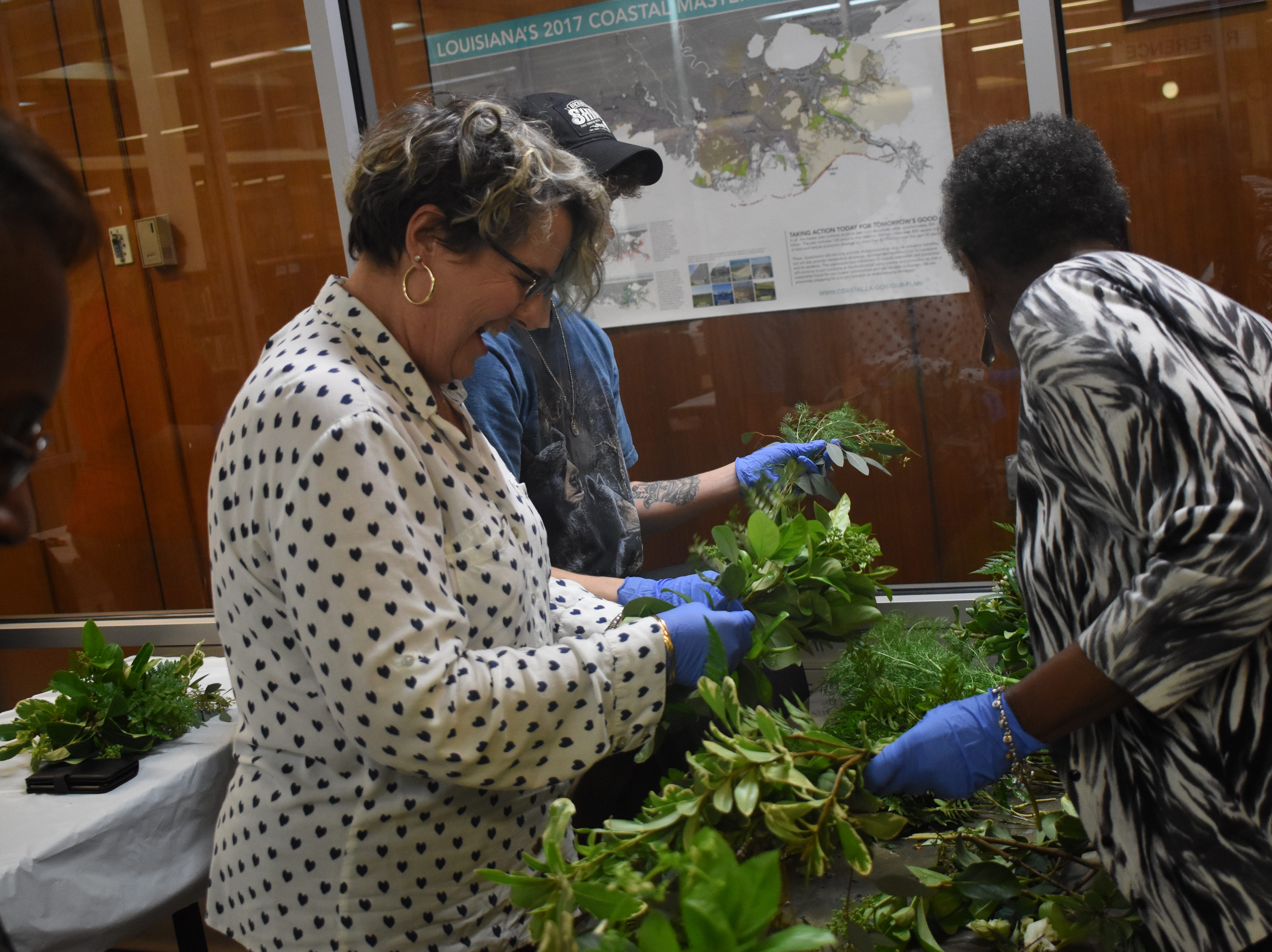 "Frances Boudreaux, a licensed florist, taught a flower arranging class, ""Flowers for your Sweetheart,"" at the Main Library of the Rapides Parish Library Wednesday, Feb. 6, 2019. Some of the tips Boudreaux told participants was to try various foliage to see what works best for them. She recommended cutting garden flowers in the morning when flowers are full of moisture and the are is cooler. Flowers such as roses, iris, gladioli can be cut as buds and may open later. Marigolds, delphiniums and dianthus or sweet William, must be cut with they are open. Some of the common foliage that were used in the arrangements that can be found in Central Louisiana are pittosporum, either variegated or solid green; baker's fern or leather leaf; sweet viburnum, sweet olive, rosemary, ginger, evergreen boughs, holly, aspidistra or iron plant, and herbs such as rosemary, lavender, mint, basil and lemon balm. 