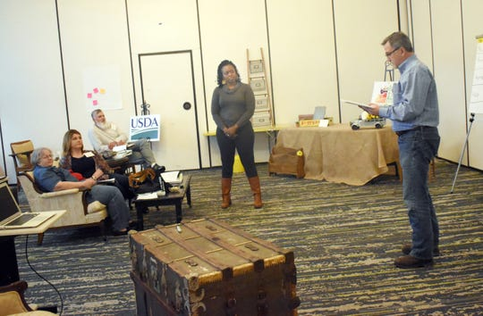 Lee Weeks (right), operating manager of Inglewood Farms, participates in an exercise led by Sagdrina Jalal (second from right), executive director of the Georgia Farmers Market Association, as the Central Louisiana Economic Development Alliance hosts the Fresh Central Certified Institute on Thursday and Friday at the Holiday Inn in downtown Alexandria.