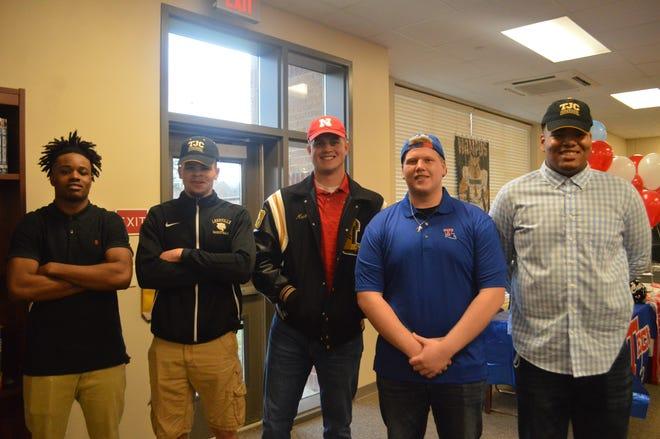 Leesville had five players sign to colleges Wednesday. From left are DeMarcus McCord (Iowa Wesleyan), Duwon Tolbert (Tyler Junior College), Matthew Anderson (Nebraska), Brett Pope (Louisiana Tech) and Montae Lynch (Tyler Junior College).