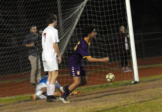 Alexandria Senior High School freshman Noor Isa (25) celebrates after scoring a goal against Pineville High School in the Division I regionals held Wednesday, Feb. 6, 2019. ASH won 4-3 in penalty kicks.