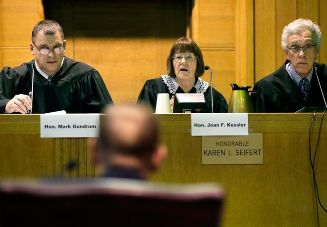 Fox Crossing Municipal Judge Len Kachinsky faces Court of Appeals Judges Mark Gundrum, Joan F. Kessler and William Brash III, during a Wisconsin Judicial Commission disciplinary hearing on Thursday at the Winnebago County Courthouse in Oshkosh.