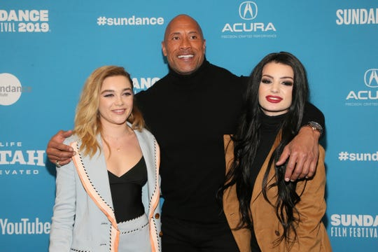 "Star Florence Pugh, from left, producer and cast member Dwayne Johnson and WWE Superstar Paige pose at the premiere of the film ""Fighting With My Family"" during the 2019 Sundance Film Festival, Jan. 28, 2019, in Park City, Utah."