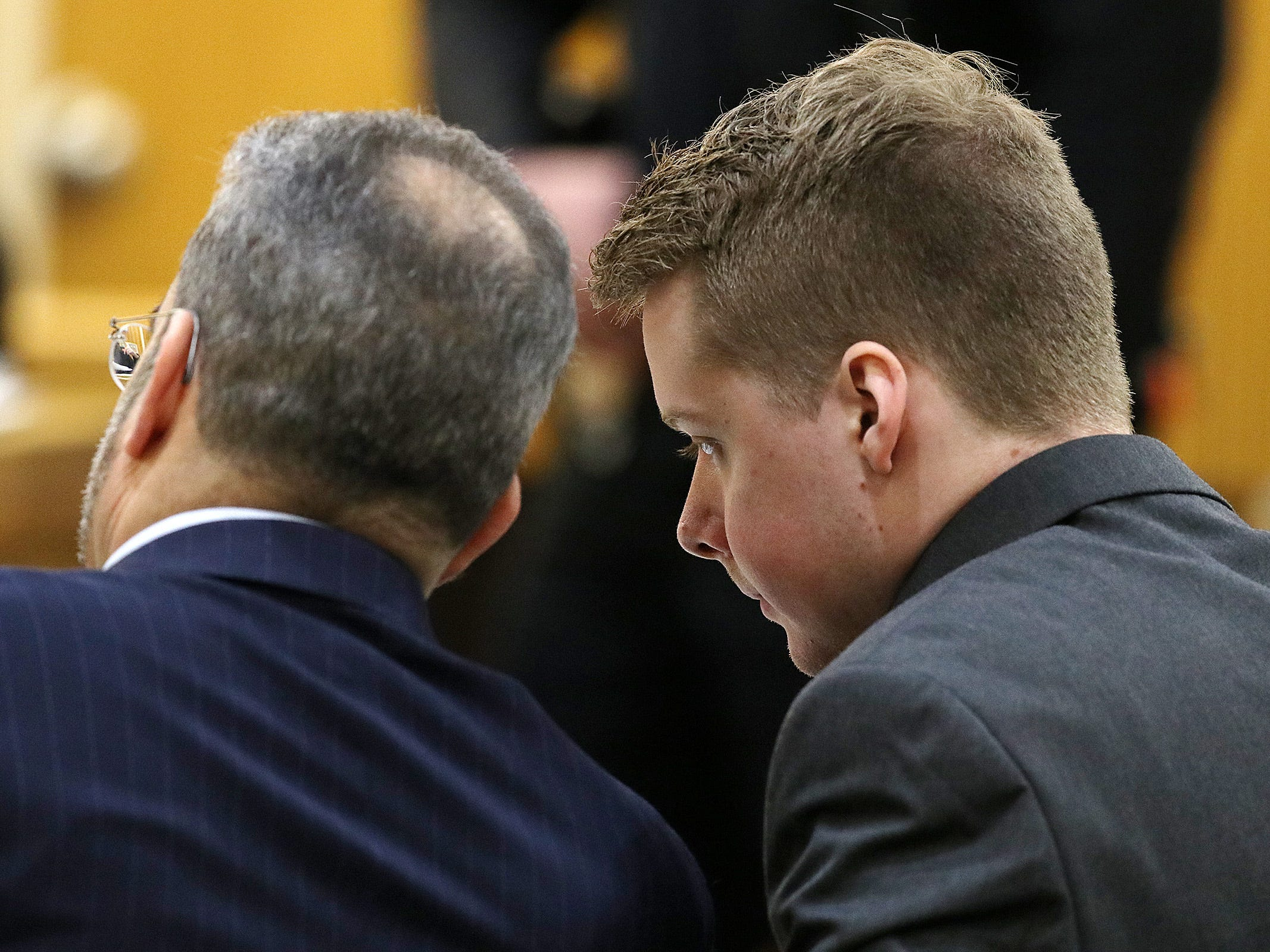 Liam McAtasney, who is charged with the murder of former high school classmate, Sarah Stern, speaks to his lawyer, Carlos Diaz-Cobo, during his trial before Superior Court Judge Richard W. English at the Monmouth County Courthouse in Freehold, NJ Thursday, February 7, 2019.