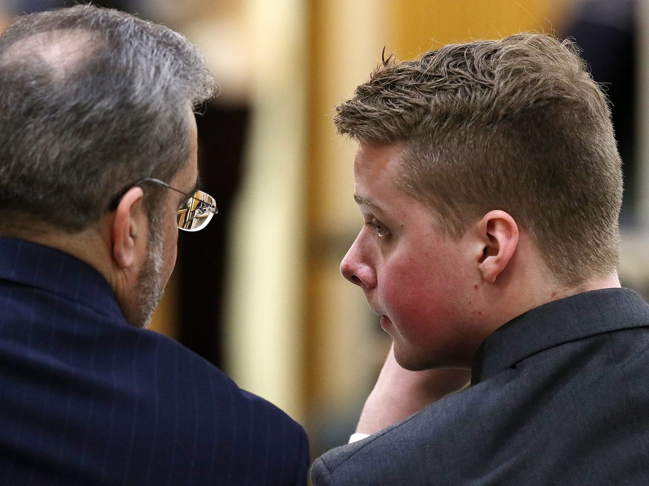 Liam McAtasney, who is charged with the murder of former high school classmate, Sarah Stern, talks to his lawyer, Carlos Diaz-Cobo, during trial before Superior Court Judge Richard W. English at the Monmouth County Courthouse in Freehold, NJ Thursday, February 7, 2019.