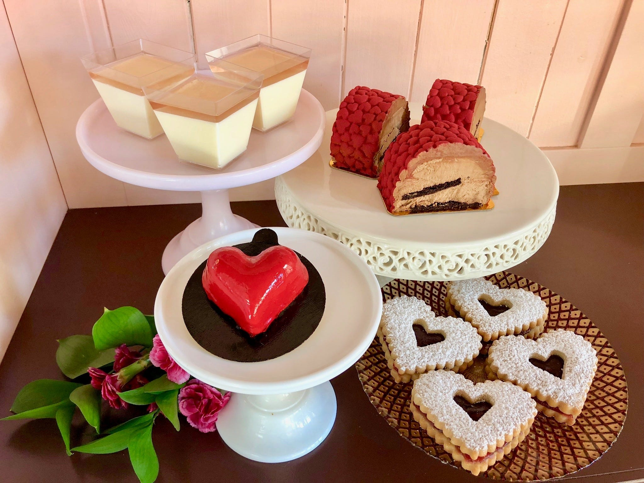 Valentine's Day offerings at Antoinette Boulangerie in Red Bank include (clockwise from top left) champagne rosé panna cotta, milk chocolate mousse cake, raspberry Linzer cookies, and  a heart-shaped vanilla cake filled with raspberry mousse and lavender cream.