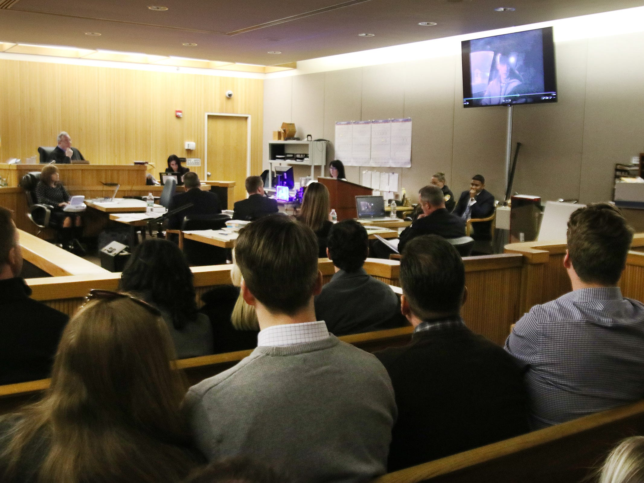 The McAtasney family watches from the gallery as a videotaped confession is played as Anthony Curry, who worked with police and recorded a confession by his friend, Liam McAtasney, testifies during the trial of Liam McAtasney, who is charged with the murder of former high school classmate, Sarah Stern, before Superior Court Judge Richard W. English at the Monmouth County Courthouse in Freehold, NJ Thursday, February 7, 2019.
