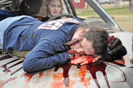 Reagan Huskin, 16, portrays a driver involved in an reenactment of a drunken driving crash where her friend, Hanna Register, 16, was ejected from the vehicle. They were part of the Shattered Dreams program at Jim Ned High School on Thursday.
