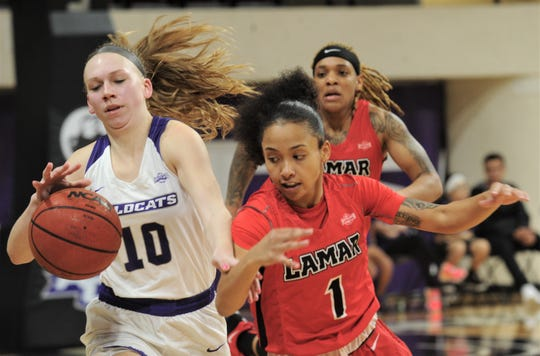 ACU's Breanna Wright (10) brings the ball upcourt in the third quarter while being defended by Lamar's Jadyn Pimentel (1). Lamar won the Southland Conference game 63-60 on Wednesday, Feb. 6, 2019, at Moody Coliseum.