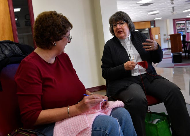 Jean Marsha (left) and Marty CashBurless talk as they work Jan. 24 with the In the Loop needle arts group at McMurry University.