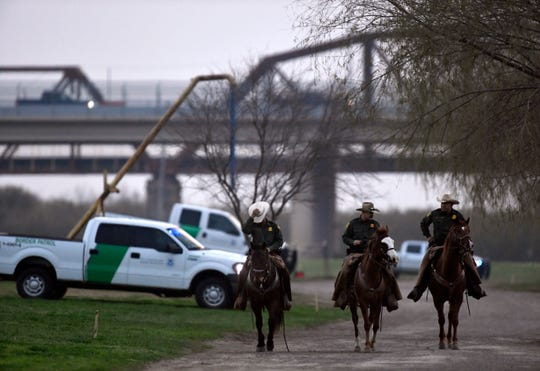 U.S. Customs and Border Protection agents in Eagle Pass ride horseback from the Camino Real International Bridge along the Rio Grande Wednesday Feb. 6, 2019. A caravan of Central American migrants has arrived in Piedras Negras and border law enforcement officials have increased their presence in response.