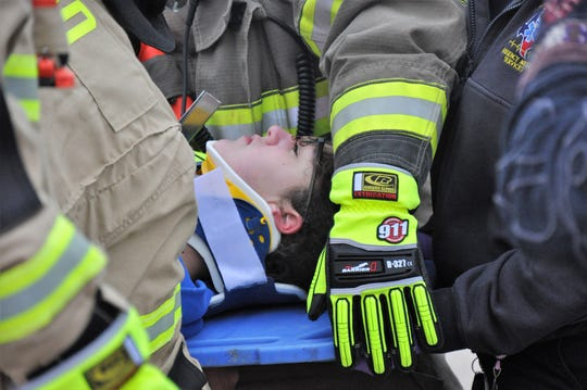 Lindley Farha, 14, portrays an injured passenger removed from a vehicle involved in a crash because of a drunken driver. The Shattered Dreams program at Jim Ned High School on Thursday included police, fire fighters and paramedics responding to a mock crash.