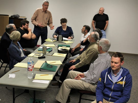 "Juror K.O. Long, standing at left, makes his point as ""12 Angry Jurors"" deliberate during rehearsal for next weekend's fundraiser at the Paramount Theatre for the Presbyterian Medical Care Mission."