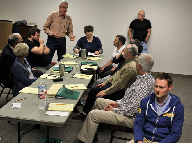 """Juror K.O. Long, standing at left, makes his point as """"12 Angry Jurors"""" deliberate during rehearsal for next weekend's fundraiser at the Paramount Theatre for the Presbyterian Medical Care Mission."""