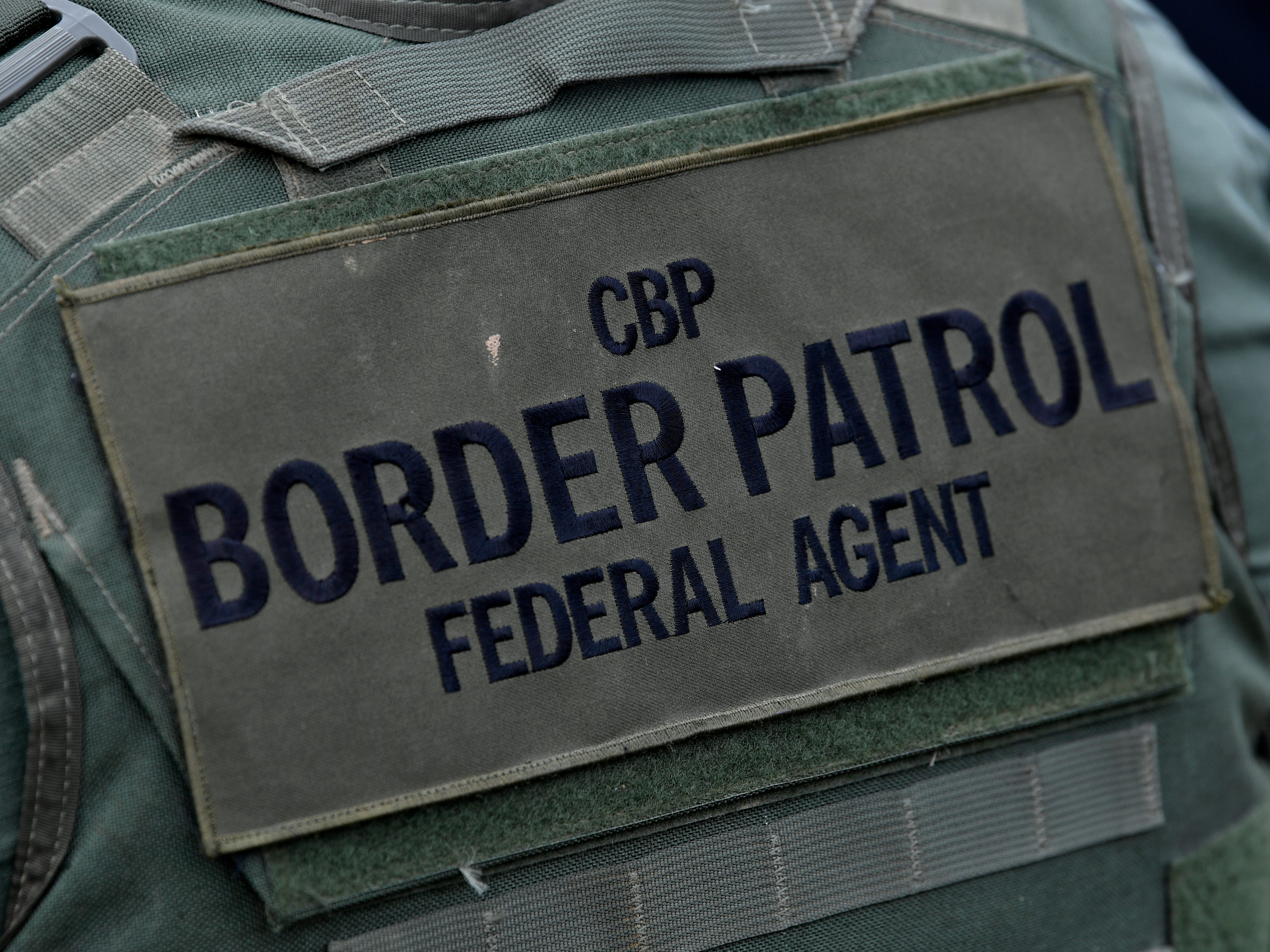 A U.S. Customs and Border Protection agent listens to a press conference in Eagle Pass Wednesday Feb. 6, 2019. Officials from CPB, the City of Eagle Pass, and the Port of Entry held an outdoor briefing not far from the Rio Grande where a large migrant caravan has arrived on the other side of the river in Piedras Negras.