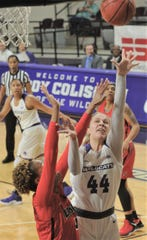 ACU's Lexie Ducat (44) puts up a shot while a Lamar player defends. Lamar won the Southland Conference game 63-60 on Wednesday, Feb. 6, 2019, at Moody Coliseum.