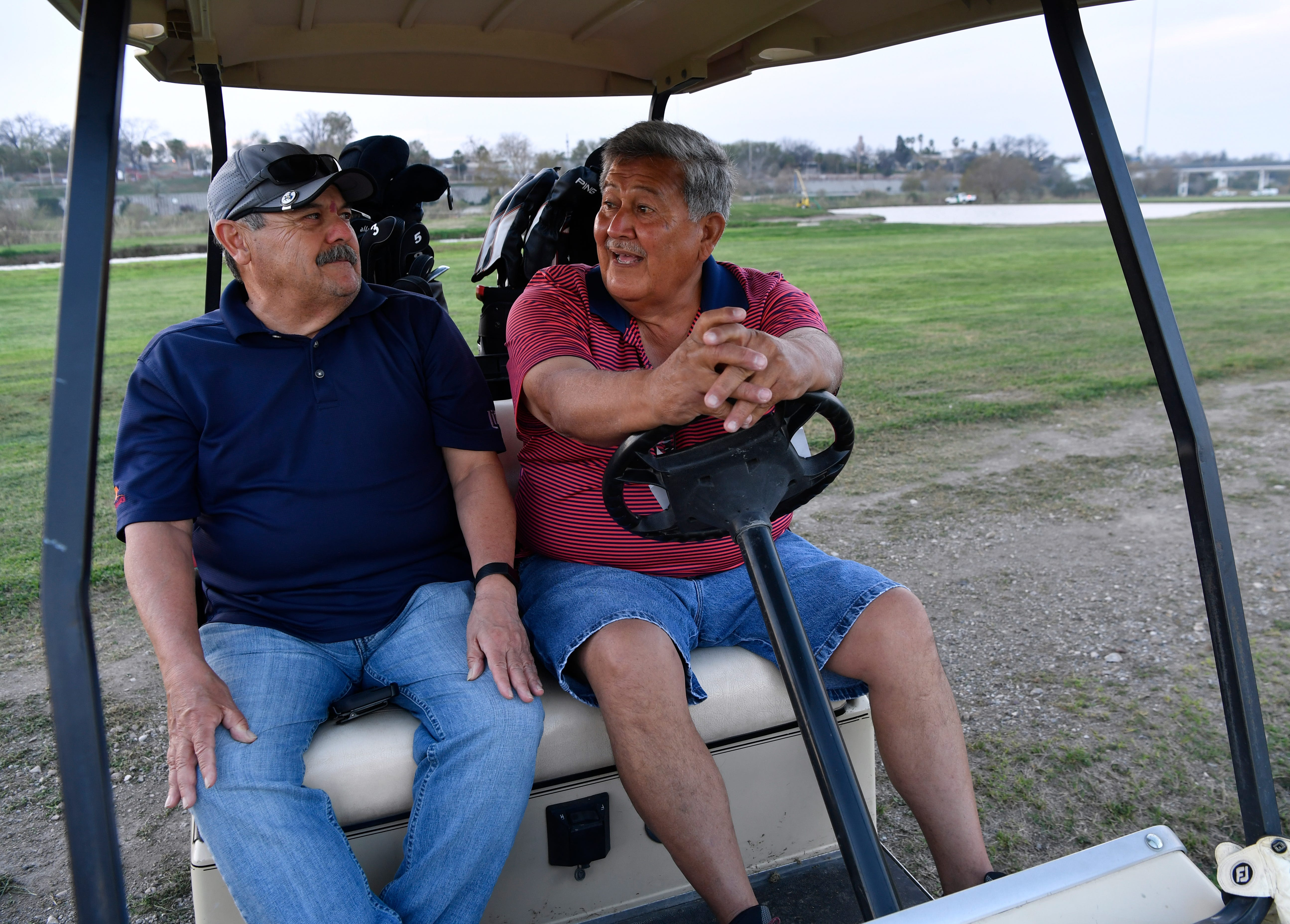 Gus Jimenez (left) and Rudy Muniz said Wednesday Feb. 6, 2019 that they've seen migrants cross the golf course between the Eagle Pass and Camino Real international bridges. A caravan of Central American migrants has arrived in Piedras Negras and border law enforcement officials have increased their presence in response.