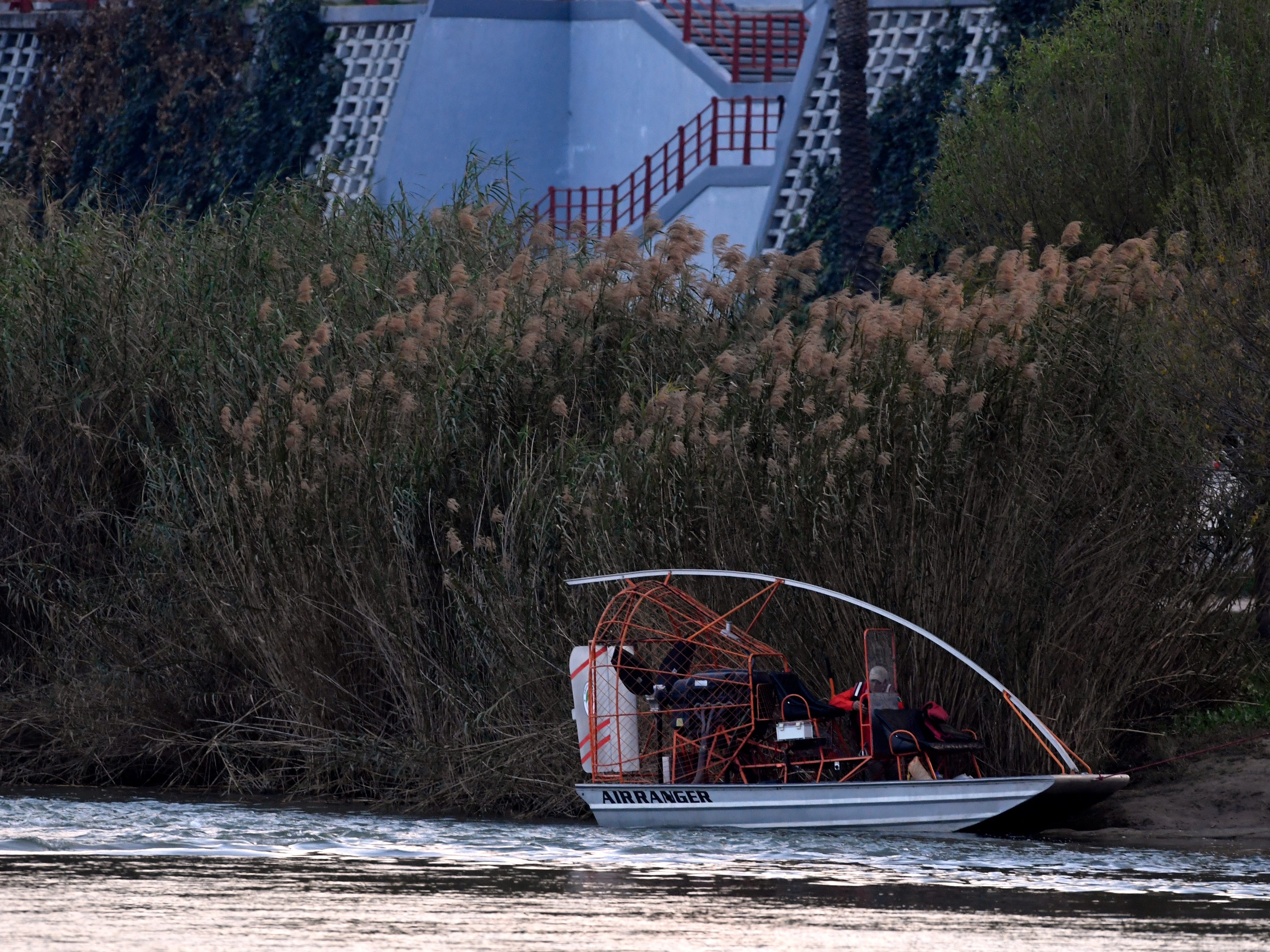 An airboat is tied on the Piedras Negras-side of the Rio Grande Wednesday Feb. 6, 2019. Deployed for rescuing migrants trying to cross the river, the boat is operated by the Mexican government.