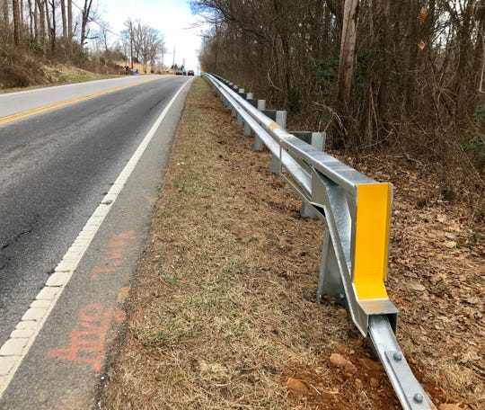 The new guard rails along Mills Gap Road cost $219,000. The N.C. DOT is installing the rail an interim safety measure before the road is widened in 2020. The rail will be reused then.