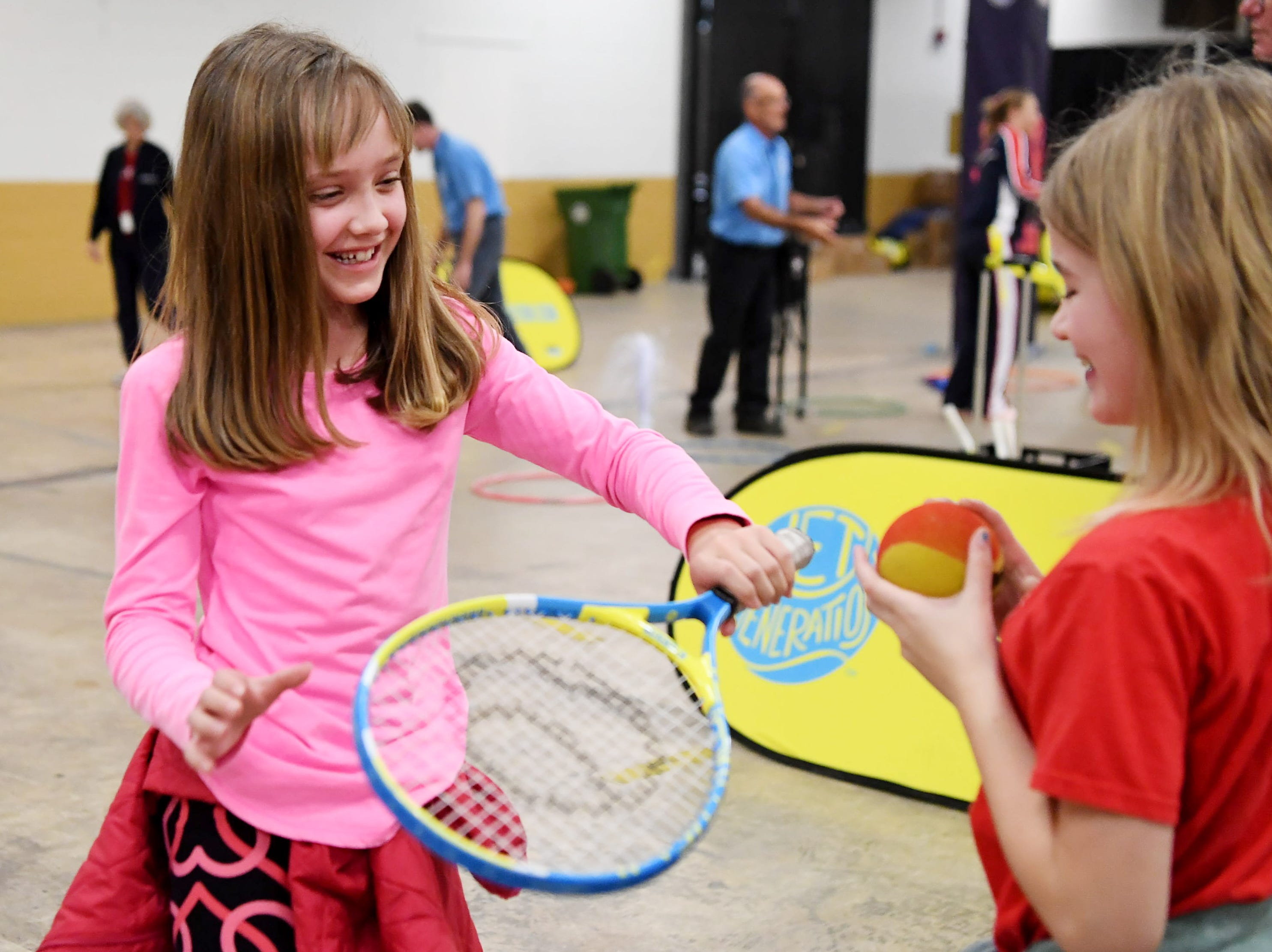 More than 200 Buncombe County elementary students learned tennis skills from volunteers with the United States Tennis Association, USTA North Carolina and US Captain Kathy Rinaldi at the US Cellular Center Wednesday, Feb. 6, 2019.