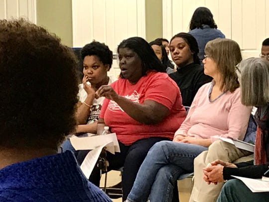 Asheville resident and elementary school teacher Libby Kyles, center, offers suggestions at Wednesday's meeting soliciting citizen input for the next police chief.
