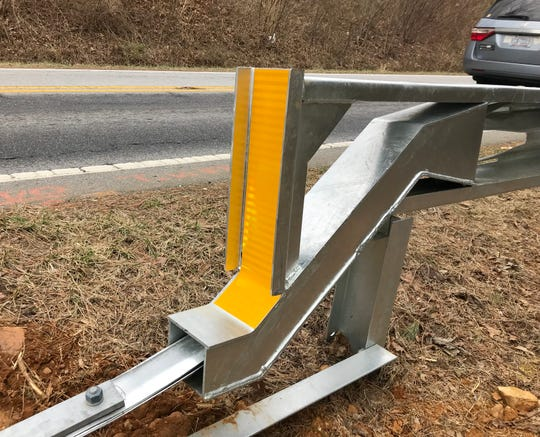The new guard rail along Mills Gap Road, which includes these impact-absorbing end rails, cost $219,000. The N.C. DOT is installing the rail an interim safety measure before the road is widened in 2020. The rail will be reused then.