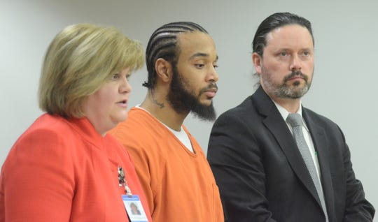 Larry Martin, center, and defense attorney Justin McCarthy listen as Assistant Attorney General Michelle Richardson speaks at the sentencing.