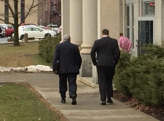Daniel Butash, right, and his defense lawyer Kurt Schrader, left, leave Broome County Court on Thursday, Feb. 7, 2019.