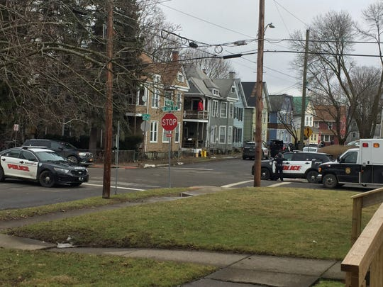 Police and SWAT officers gather Thursday on Winding Way in Binghamton.