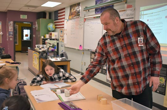 Kingston Middle School science teacher Ted Jez explains plate tectonics to his sixth-grade Earth Sciences class at Kingston Middle School on Feb. 6.