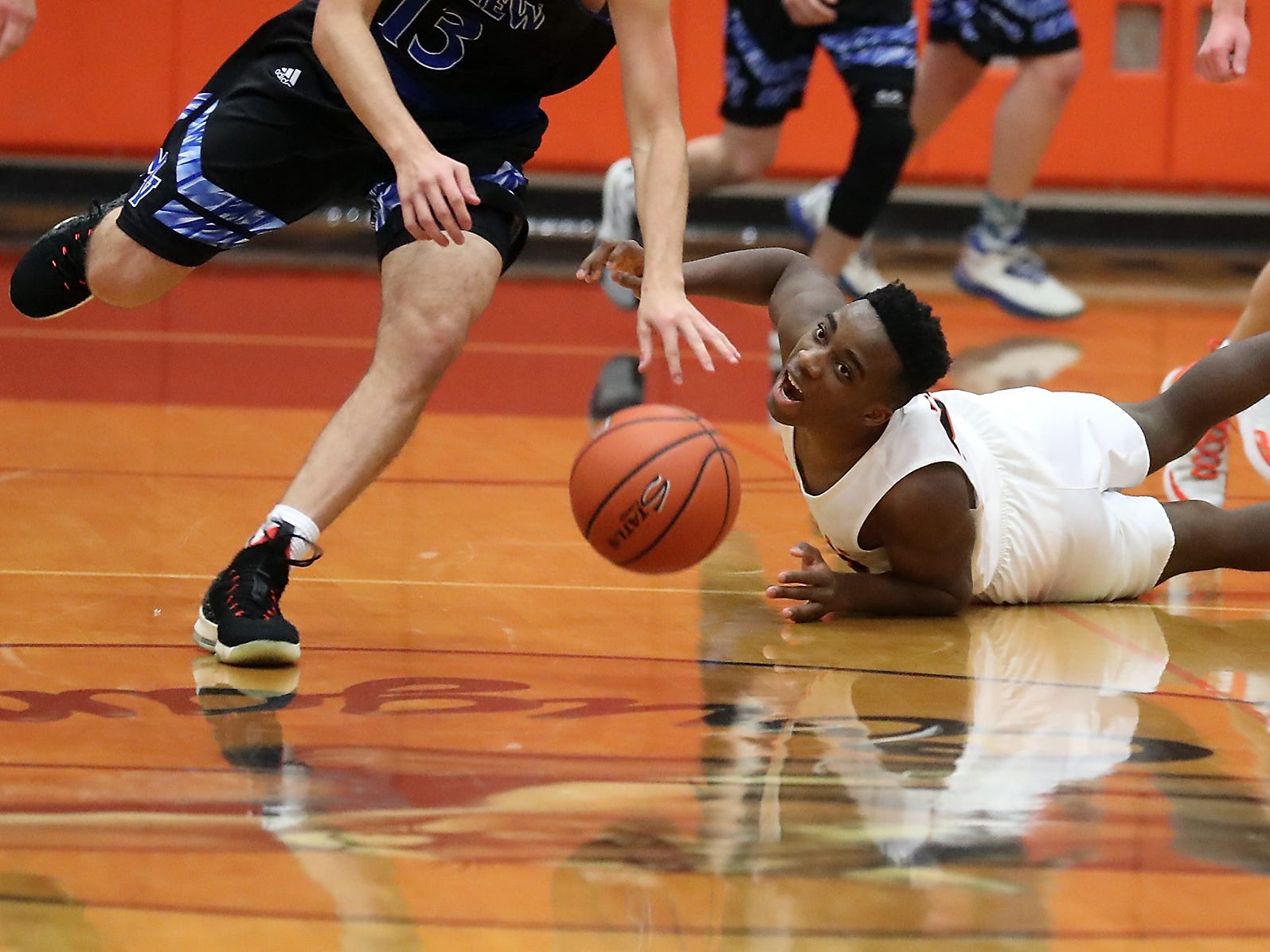 Central Kitsap's Elijah McGee hits the floor after making a dove for a loose ball- that was picked up by Mountain View's Sam Frosh - during the second half of their game in Silverdale on Wednesday, February 6, 2019.