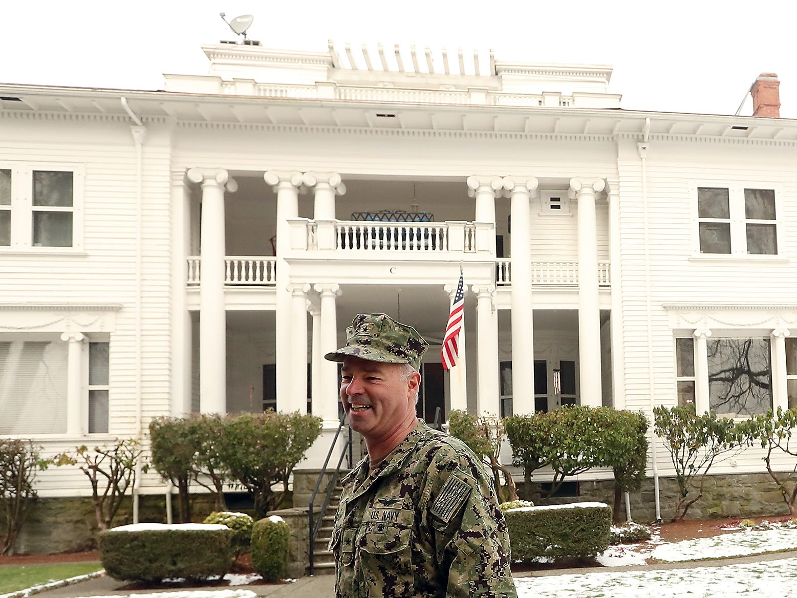 Rear Admiral Scott Gray, Commander of Navy Region Northwest, in front of the 1896 historical house that his family lives in called Quarters C at Naval Base Kitsap Bremerton on Thursday, February 7, 2019.