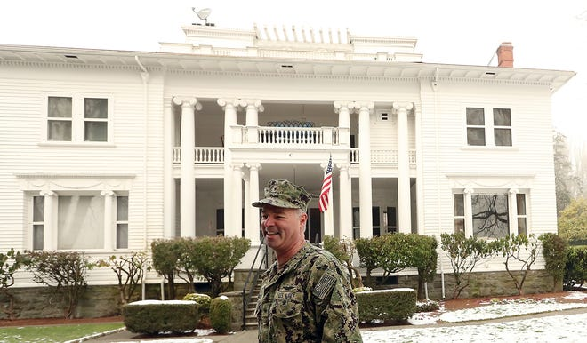 Rear Adm. Scott Gray, commander of Navy Region Northwest, in front of the 1896 historical house that his family lives in called Quarters C at Naval Base Kitsap Bremerton on Thursday.