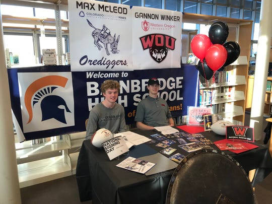 Bainbridge football players Max McLeod (left) and Gannon Winker signed letters of intent Wednesday to play next season in college. McLeod is going to the Colorado School of Mines and Winker is headed to Western Oregon University.