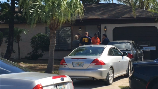 The FBI is investigating a home in Palm Bay. No details were released after the early morning raid Thursday.