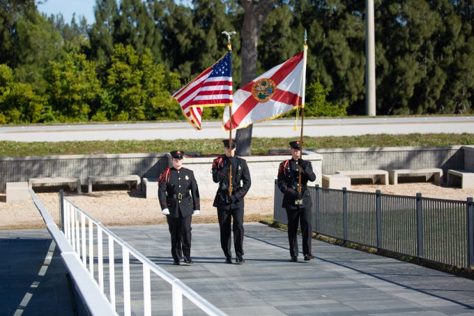 Brevard County Fire Rescue's color guard approaches the Space Mirror Memorial for NASA's Day of Remembrance at the Kennedy Space Center Visitor Complex on Thursday, Feb. 7, 2019.