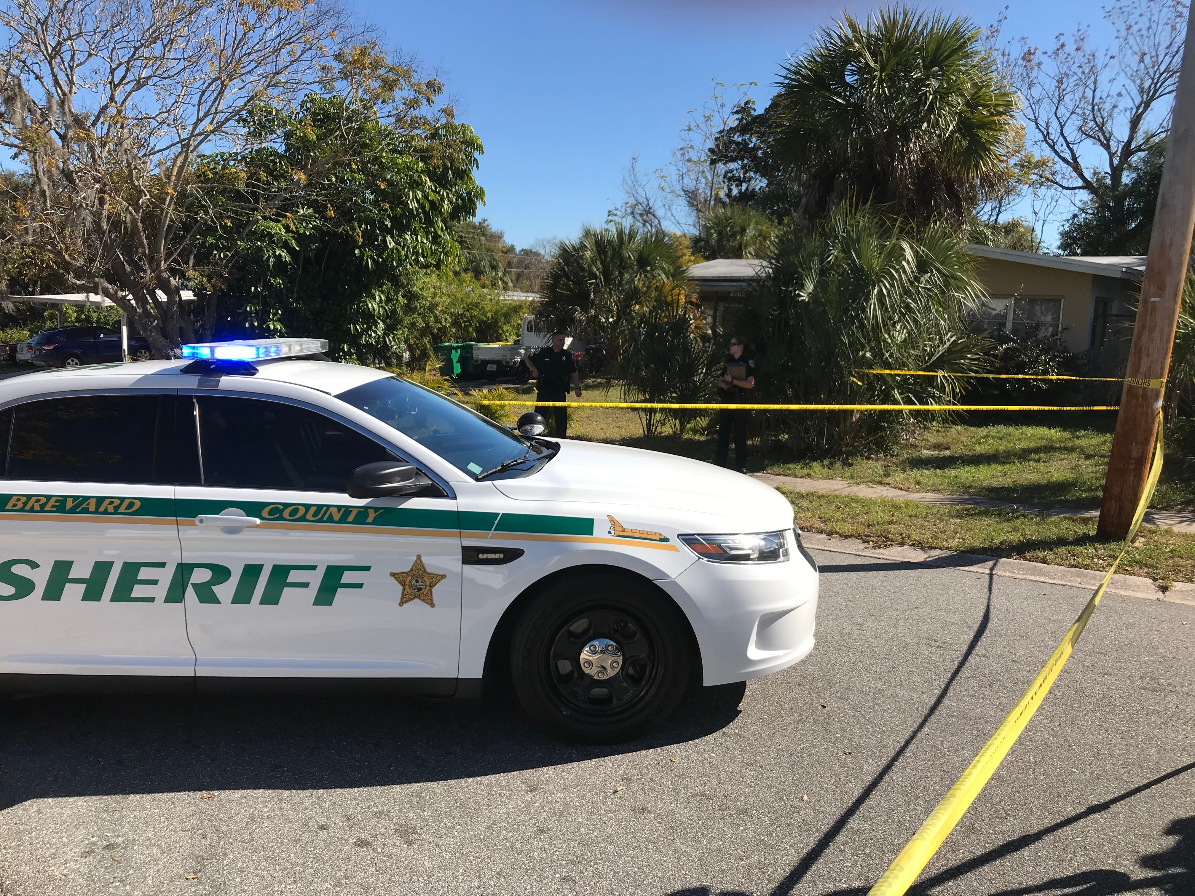 Sheriff's deputies investigate a home invasion in Mims Thursday, Feb. 7, 2019.