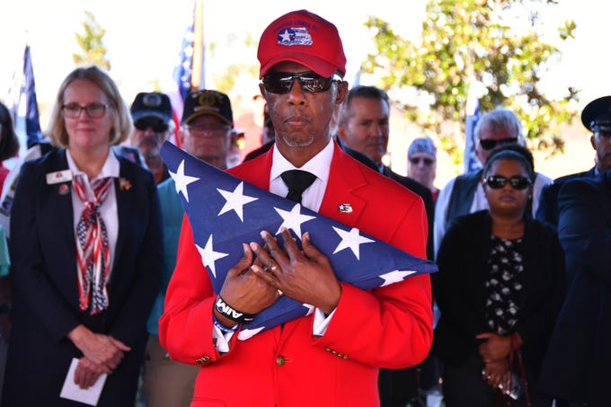 "A folded flag to be  presented to Leslie Cowan, daughter of the Cowans. A reburial ceremony was held at the Cape Canaveral National Cemetery Thursday afternoon for Flight Officer Edwin ""Eddie"" Cowan and his wife Theda with full military honors."
