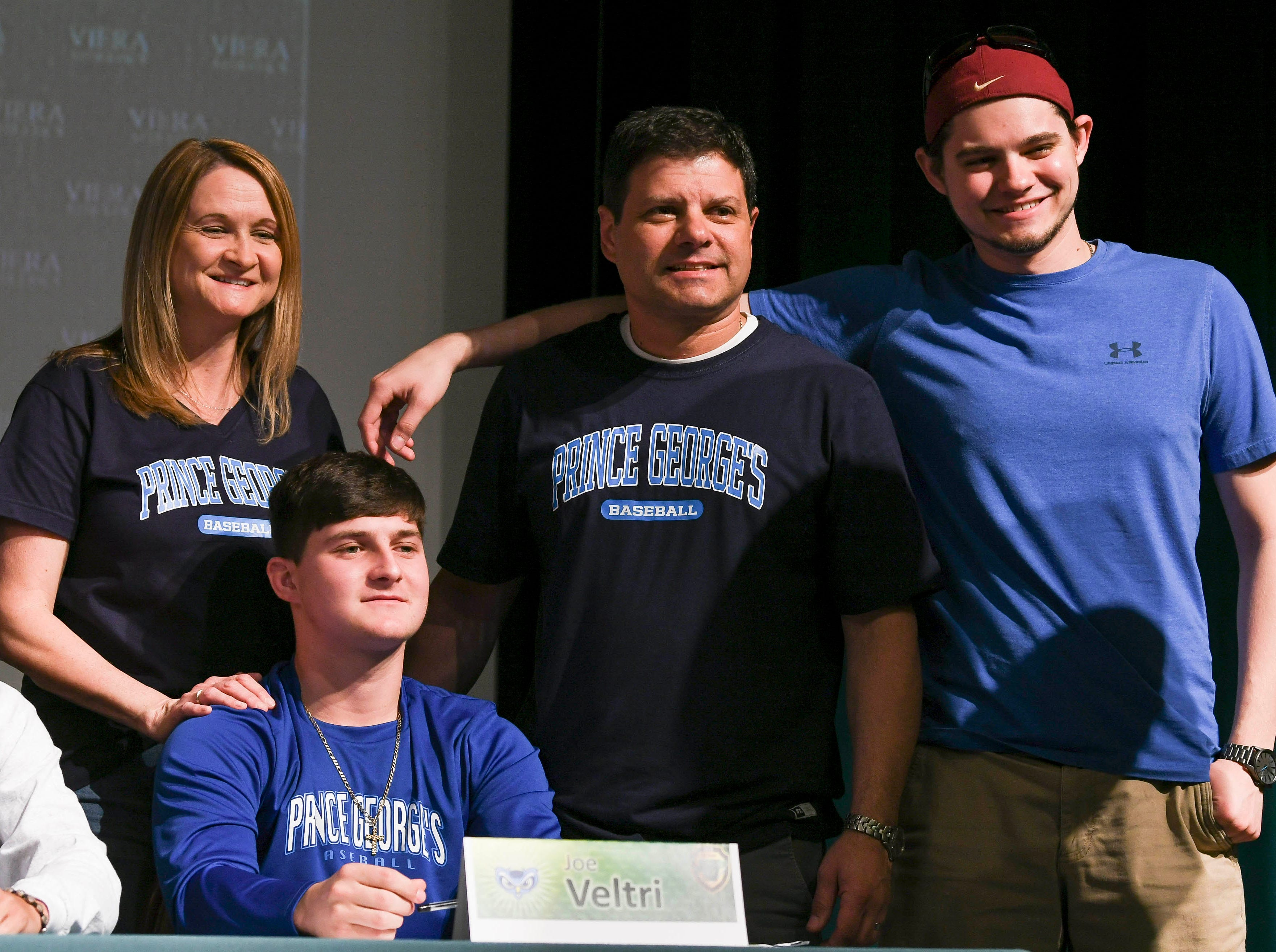 Viera High senior Joe Veltri gets his picture taken after signing his letter of intent Wednesday on National Signing Day.