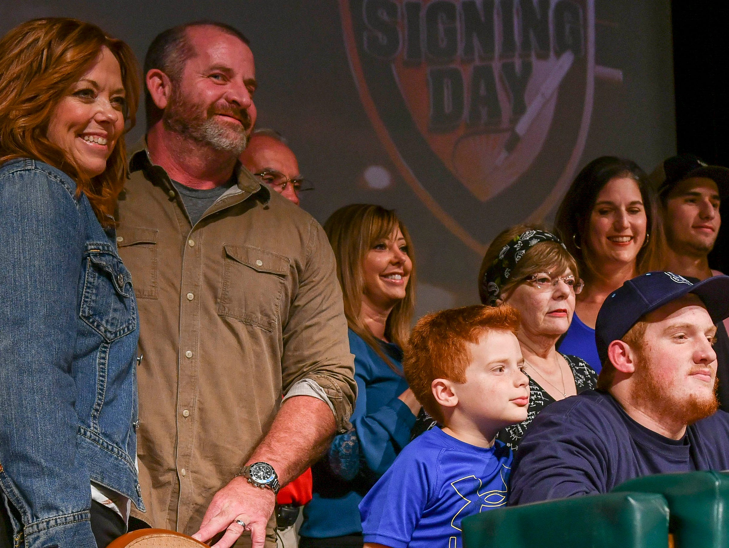 Viera High senior Chris Murphy has his photo taken with family and friends Wednesday during National Signing Day at the school.