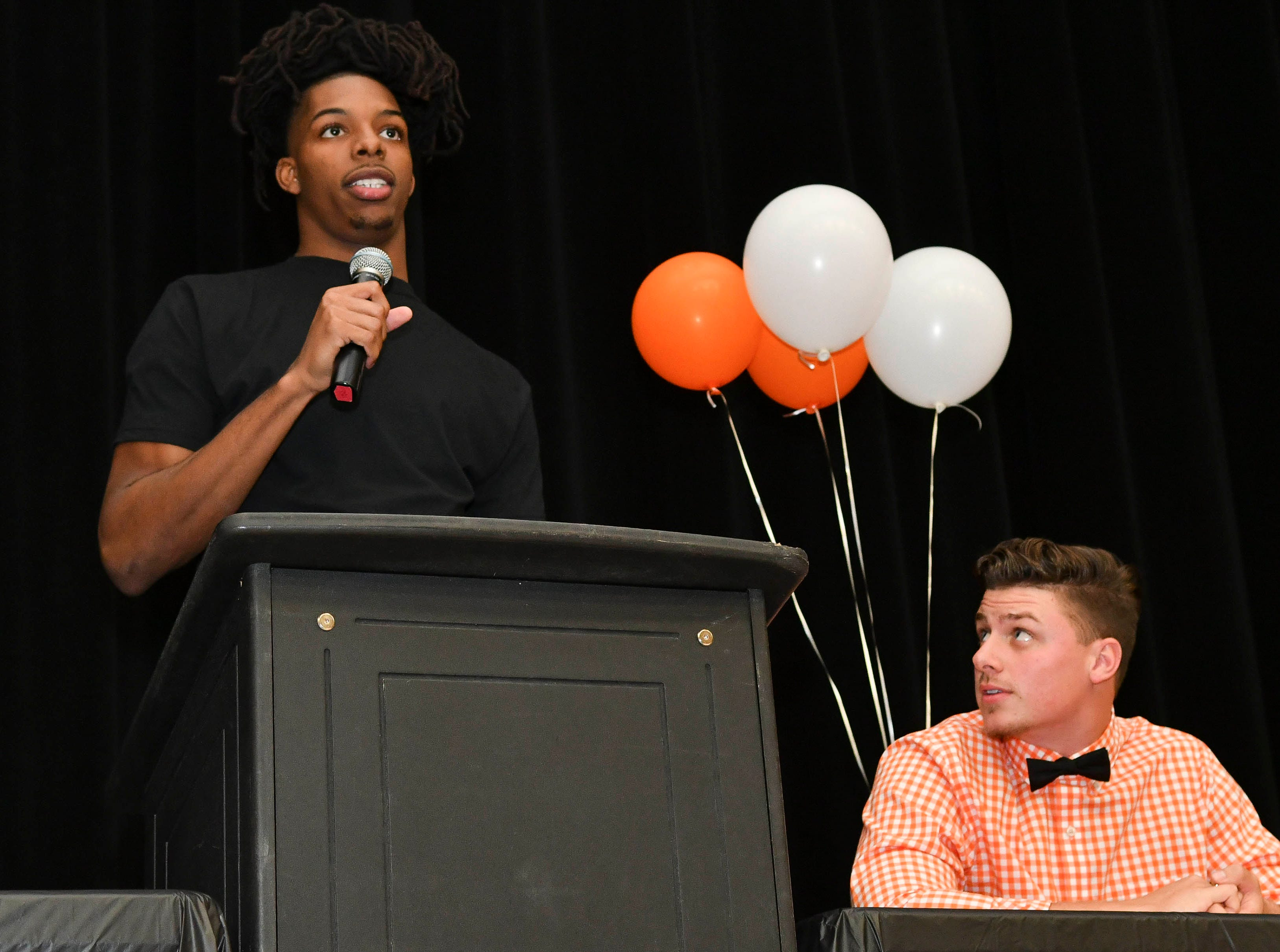 Rashean Lynn thanks the people that helped him succeed on National Signing Day at Cocoa High School.  He will attend West Virginia.  Watching Lynn is Alex Petruzzello, who signed to attend Tusculum College.