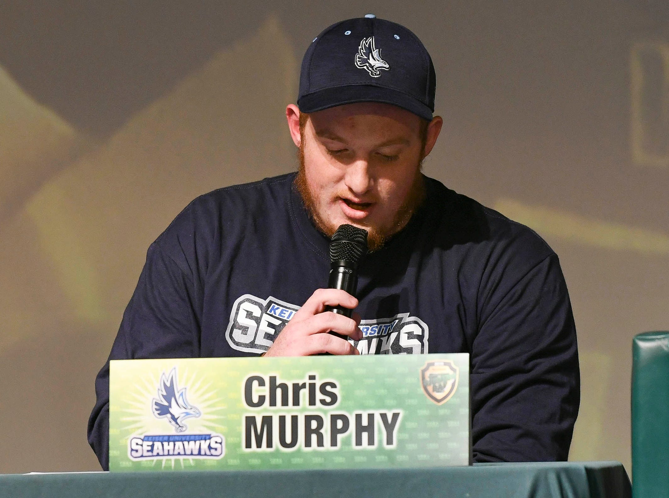 Viera High senior Chris Murphy announces his choice of school after signing his letter of intent on National Signing Day..